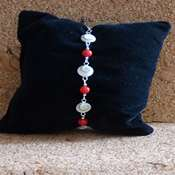 bracelet oeil ste lucie perles rouges- boslpr - Copie